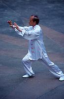 A tai chi teacher teaches students in Hong Kong Park, Hong Kong, China.