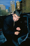 Rowan Atkinson leaves a Sydney press conference.
