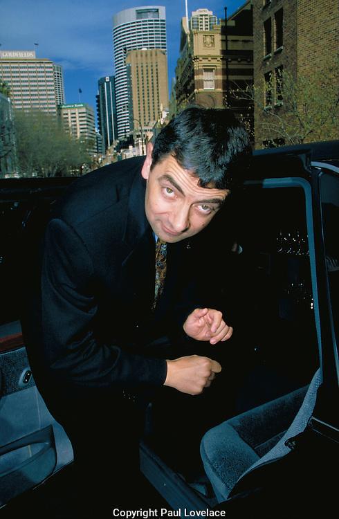 Rowan Atkinson leaves a Sydney press conference.