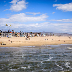 Photo of Newport Beach in Orange County California with Pacific Ocean shoreline, oceanfront homes on Balboa Peninsula in Southern California.