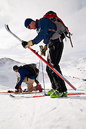 Skiers, Neil Mendall and Celin Serbo, prepare themselves to ski the  backcountry bowls at Loveland Pass, Colorado.