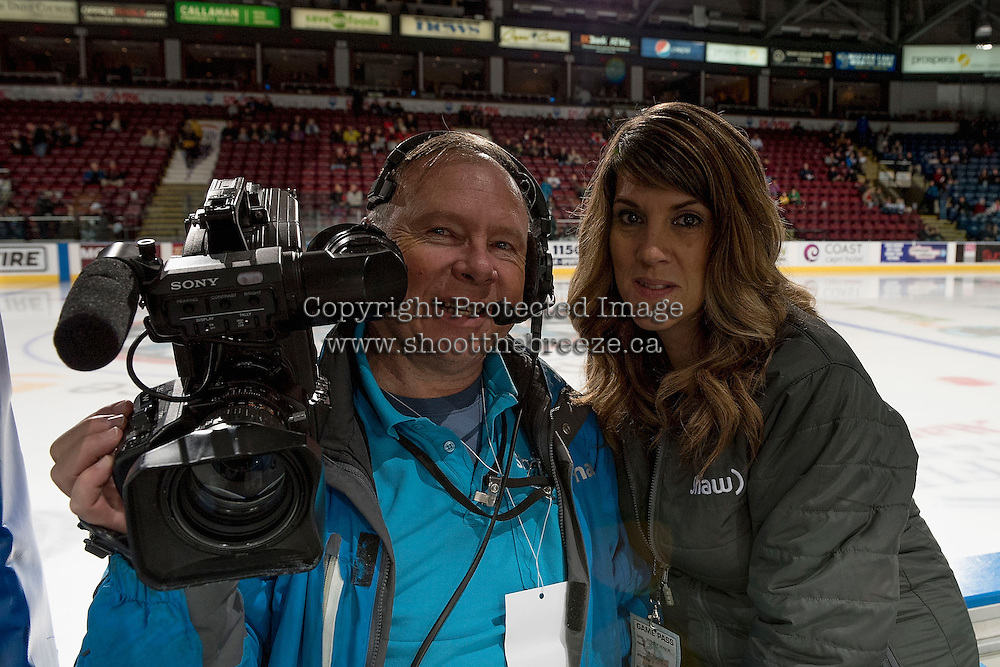 KELOWNA, CANADA - OCTOBER 26: Shaw television broadcasters Wayne McDougall and Tamie Williams stand on the bench as the Kelowna Rockets take on the Victoria Royals on October 26, 2016 at Prospera Place in Kelowna, British Columbia, Canada.  (Photo by Marissa Baecker/Shoot the Breeze)  *** Local Caption ***