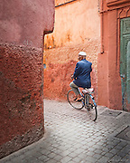 The narrow streets in the older medina in Marrakesh, Morocco become walkways in some places allowing only bicycles and walking as a mode of transportation.
