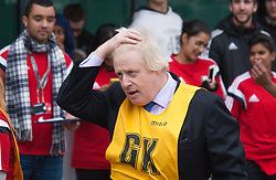 Ealing, London, December 9th 2014. Mayor of London Boris Johnson visits Ealing, Hammersmith and Fulham College accompanied by   Deputy Mayor for Policing and Crime Stephen Greenhlagh to launch a new initiative to increase black and ethnic minority applicants to the Met. PICTURED: Boris Johnson regrets missing the net after trying to score in an