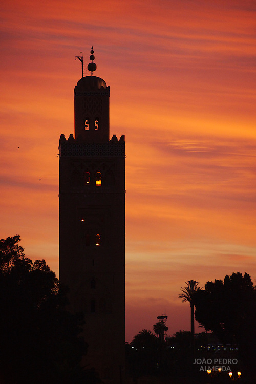 Sunset over the tower of the main mosque of Marrakech