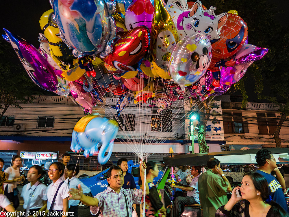 20 NOVEMBER 2015 - BANGKOK, THAILAND: An inflatable toy vendor at the Wat Saket temple fair. Wat Saket is on a man-made hill in the historic section of Bangkok. The temple has golden spire that is 260 feet high which was the highest point in Bangkok for more than 100 years. The temple construction began in the 1800s in the reign of King Rama III and was completed in the reign of King Rama IV. The annual temple fair is held on the 12th lunar month, for nine days around the November full moon. During the fair a red cloth (reminiscent of a monk's robe) is placed around the Golden Mount while the temple grounds hosts Thai traditional theatre, food stalls and traditional shows.     PHOTO BY JACK KURTZ