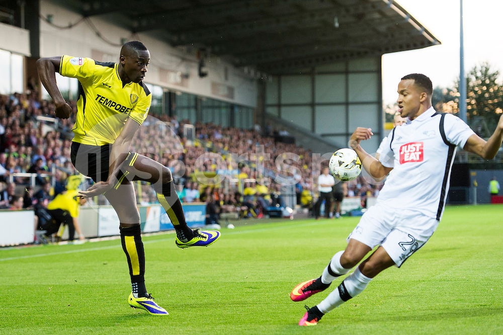 Lucas Akins of Burton Albion crosses the ball but gets blocked by Marcus Olsson of Derby County during the EFL Sky Bet Championship match between Burton Albion and Derby County at the Pirelli Stadium, Burton upon Trent, England on 26 August 2016. Photo by Brandon Griffiths.
