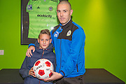Forest Green Rovers Liam Noble(15) presents Morgan, representing match ball sponsors Grundon with a ball during the Vanarama National League match between Forest Green Rovers and Dover Athletic at the New Lawn, Forest Green, United Kingdom on 17 December 2016. Photo by Shane Healey.