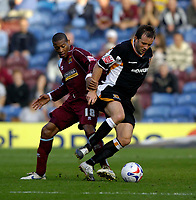Photo: Jed Wee.<br />Burnley v Hull. Coca Cola Championship. 14/10/2006.<br /><br />Hull's Ian Ashbee (R) tries to get away from Burnley's Micah Hyde.