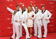 "COMMERCIAL IMAGE - In this image provided by American Heart Association, actress Jennifer Coolidge, center, helps unveil the American Heart Association's National Hands-Only CPR campaign launch, Tuesday June 5, 2012, in New York.  The campaign teaches the two steps of Hands-Only CPR:  Call 911 and push hard and fast in the center of the chest to the beat of the disco classic ""Stayin' Alive.""  For more information visit www.heart.org/handsonlycpr.   (Photo by Diane Bondareff/Invision for AHA/AP Images)"