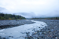 """Scenic image of glacial creek flowing into the Tashenshini River. The """"Tat"""" flows out of Yukon, CA, through British Columbia and empties into Glacier Bay National Park in Alaska, US."""