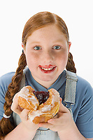 Overweight girl holding pastry, portrait