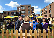 SOUTH BERMONDSEY, LONDON: (L-R) Ed Balls, and residents, Gillian Warren, Alfie Warren, Patricia Ofoche, Nneka Ofoche.  Ed Balls, Labour Leadership candidate joins shadow housing minister John Healey and  shadow work and pensions secretary Yvette Cooper  during a visit to a housing development, The Falcon Works development, in central London on 31 August 2010. STEPHEN SIMPSON..