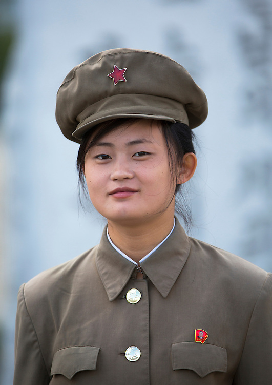 Female guard at Mansudae art studio in Pyongyang, North Korea.