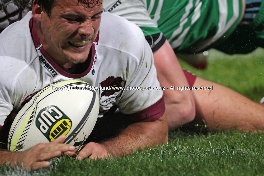 North Harbour`s Luke Devcich  touches down a try in an ITM Cup Rugby Match, North Harbour v Manawatu, QBE Stadium, Auckland, New Zealand, Friday, September 12, 2014. Photo: David Rowland/Photosport