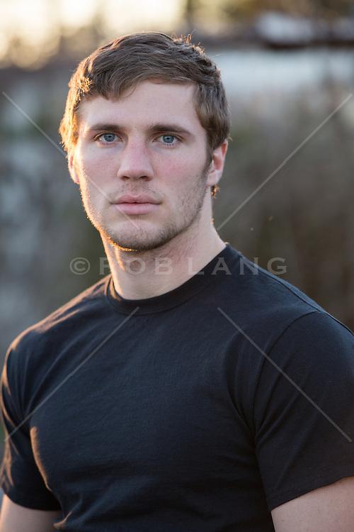 handsome man at sunset looking at camera