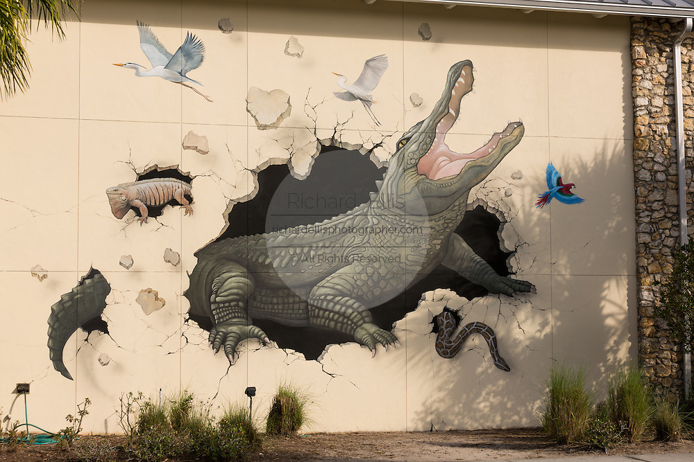 Alligator mural at the entrance to Gatorland theme park and wildlife preserve located along South Orange Blossom Trail in Orlando, Florida. It was founded by Owen Godwin in 1949.