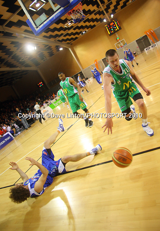 Saints forward Casey Frank goes down after a collision with Calum McLeod.<br /> NBL - Wellington Saints v Manawatu Jets at Te Rauparaha Arena, Porirua. Friday, 11 June 2010. Photo: Dave Lintott/PHOTOSPORT