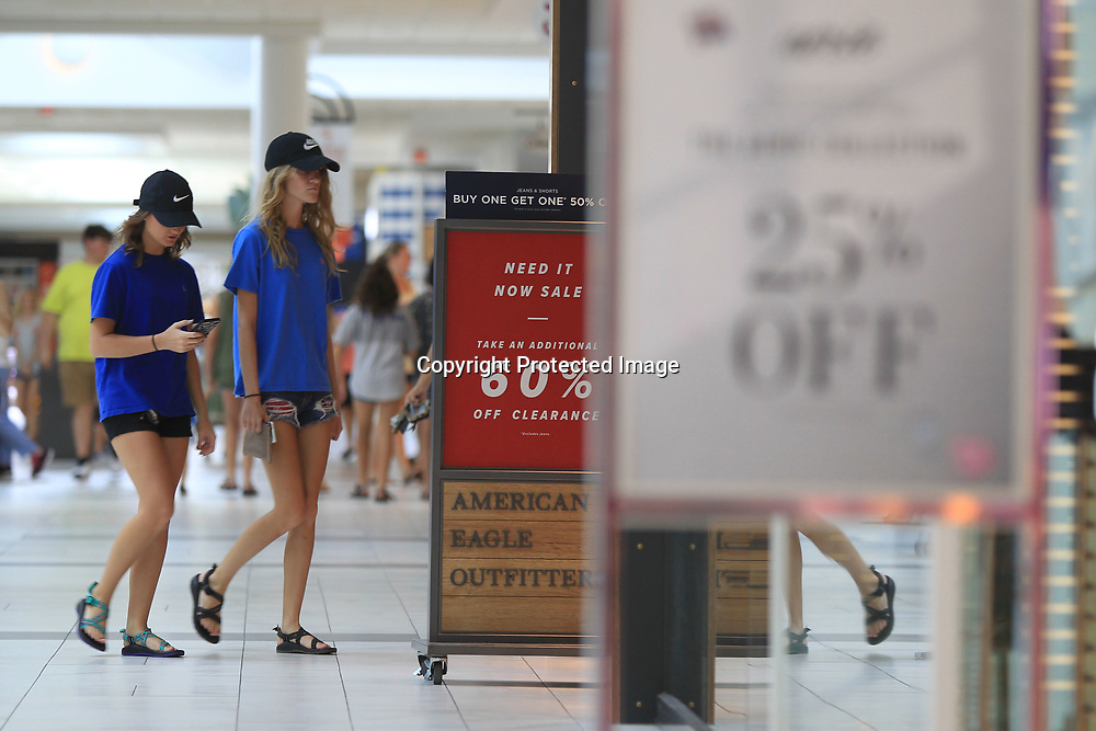 Shoppers look for back to school shopping deals inside the Mall at Barnes Crossing on Tuesday afternoon.