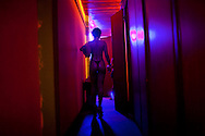 In this photo taken May 5, 2011, a sex worker enters a cubicle where she sees her clients at Vila Mimosa prostitution zone in Rio de Janeiro, Brazil. <br /> <br /> Spelling the possible end of Vila Mimosa is a high-speed train the government wants to build to link Rio to Sao Paulo, as part of Brazil's Olympic proposal. The government is expected to open bidding to prospective builders July 29.