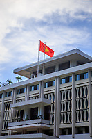 The Vietnamese flag flies over the Independence Place in Ho Chi Minh City, Vietnam