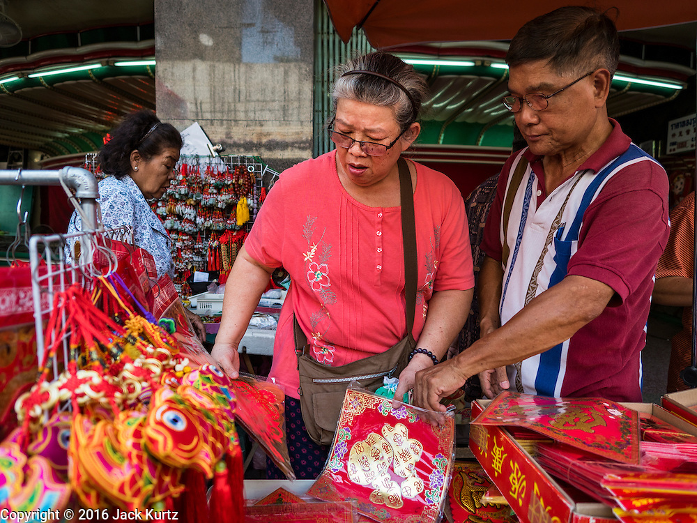 "03 FEBRUARY 2016 - BANGKOK, THAILAND:  People for Chinese New Year mementos before Chinese New Year in Bangkok. Thailand has the largest overseas Chinese population in the world; about 14 percent of Thais are of Chinese ancestry and some Chinese holidays, especially Chinese New Year, are widely celebrated in Thailand. Chinese New Year, also called Lunar New Year or Tet (in Vietnamese communities) starts Monday February 8. The coming year will be the ""Year of the Monkey.""            PHOTO BY JACK KURTZ"