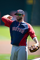 OAKLAND, CA - JUNE 22:  Dustin Pedroia #15 of the Boston Red Sox throws a baseball during batting practice before the game against the Oakland Athletics at O.co Coliseum on June 22, 2014 in Oakland, California. The Boston Red Sox defeated the Oakland Athletics 7-6 in 10 innings.  (Photo by Jason O. Watson/Getty Images) *** Local Caption *** Dustin Pedroia