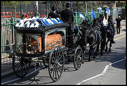 The horse drawn hearse carrying  the coffin of the former general secretary of the RMT union Bob Crow from Woodford Green to the City of London Cemetery and Crematorium North East, London, United Kingdom. Monday, 24th March 2014. Picture by Andrew Parsons / i-Images