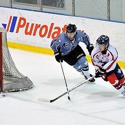 TORONTO, ON - Nov 16, 2014 : The 2014 Central Canada Cup Challenge game between LHJQ Team St. Louis and OJHL Team Nieuwendyk. Alexis Guilbault #16 D'Equipe Quebec St. Louis shoots the puck while being pursued by Austin Brown #2 of Team Nieuwendyk during second period game action.<br /> (Photo by Shawn Muir / OJHL Images)