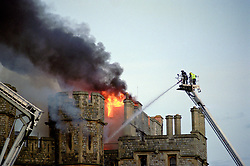 File photo dated 20/11/92 of firemen tackling the blaze which ripped through Windsor Castle, as the Private Chapel at Windsor Castle, where Archie Mountbatten-Windsor will be christened, had to be entirely rebuilt following the devastating Windsor Castle fire in 1992.