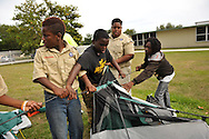 Scout Arcolian Johnson (center) stands behind his fellow Boy Scout Troop 772 members as his team races to pitch a tent at Dan McCarty Middle School in Fort Pierce on April 30, 2014. (XAVIER MASCAREÑAS/TREASURE COAST NEWSPAPERS)