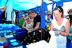 Fans have a look at the shop set up at the fun day - Photo mandatory by-line: Dougie Allward/JMP - Tel: Mobile: 07966 386802 21/07/2013 - SPORT - FOOTBALL - Bristol -  Bristol Rovers Fun Day
