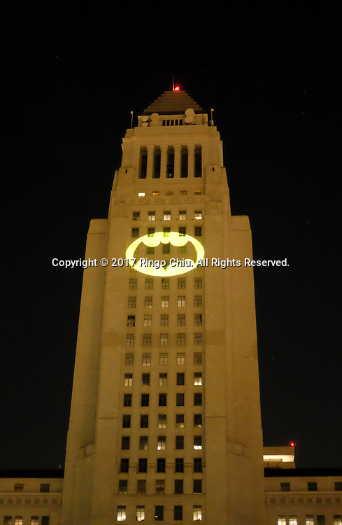 The Bat-signal is projected onto Los Angles City Hall during a tribute to pop-culture icon Adam West in Los Angeles, June15, 2017.(Photo by Ringo Chiu)<br /> <br /> Usage Notes: This content is intended for editorial use only. For other uses, additional clearances may be required.