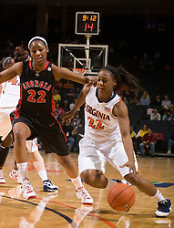 Virginia forward Monica Wright (22) dribbles past Georgia guard Christy Marshall (22).  The #15 ranked Virginia Cavaliers defeated the Georgia Lady Bulldogs 62-60 in NCAA Women's Basketball at the John Paul Jones Arena on the Grounds of the University of Virginia in Charlottesville, VA on January 2, 2009.