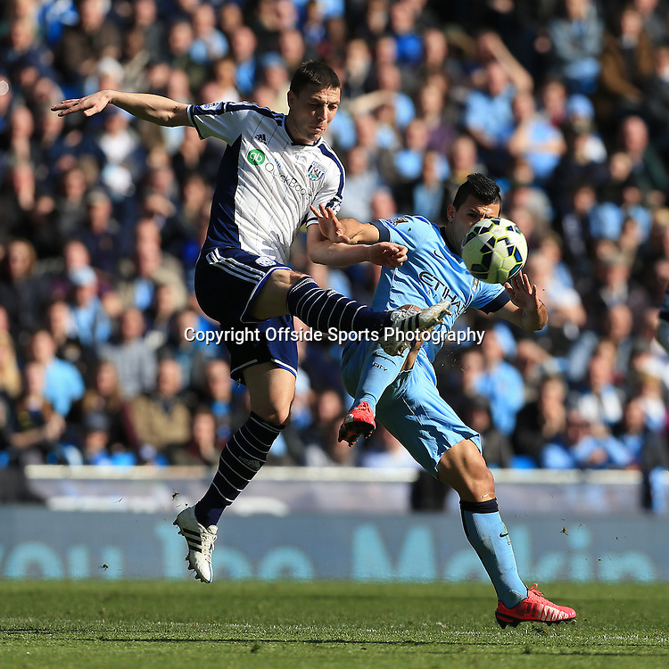 21st March 2015 - Barclays Premier League - Manchester City v West Bromwich Albion - Chris Baird of West Brom battles with Sergio Aguero of Man City - Photo: Simon Stacpoole / Offside.