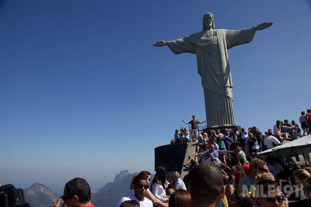 Looking up at tourist and Christ the redeemer, Rio de Janeiro, Brazil.