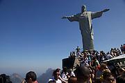 Looking up at tourist and Christ the redeemer, Rio de Janeiro, Brazil.