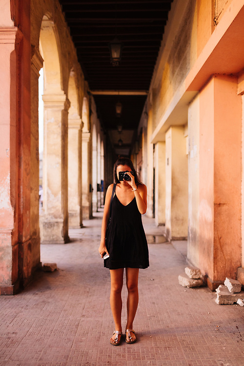 20 something takes photograph in Old Havana, Havana Cuba