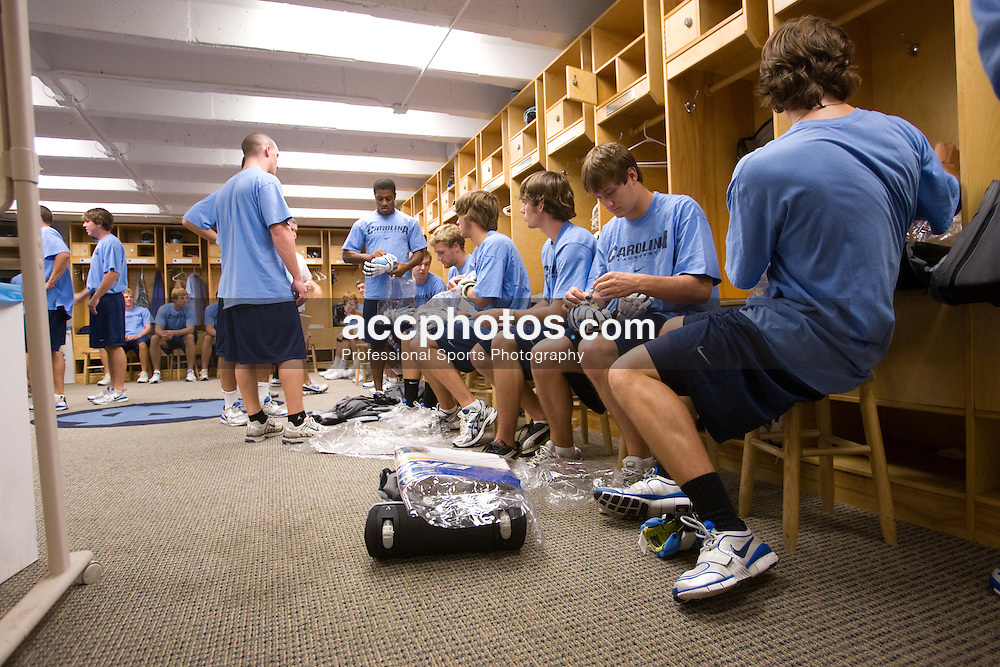 06 September 2007: North Carolina Tar Heels men's lacrosse freshmen (sitting right to left) Kevin Piegare, Chris Hunt, Jamie Locke, Billy Bitter, Scott Bollert and standing left to right Nick Tintle (senior; shaved head) and Milton Lyles with their new equipment at the Kenan Stadium Field House in Chapel Hill, NC.