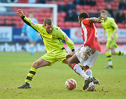 LONDON, ENGLAND - Saturday, January 30, 2010: Charlton Athletic's Jose Semedo and Tranmere Rovers' John Welsh in action during the Football League One match at the Valley. (Photo by Gareth Davies/Propaganda)