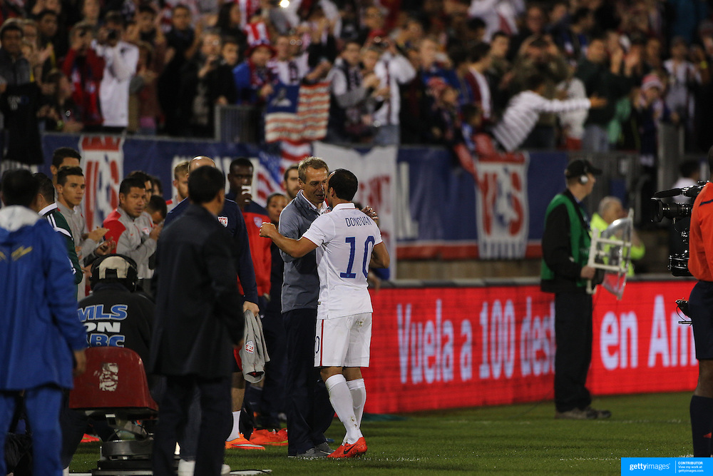 Landon Donovan, USA, is congratulated by coach Jürgen Klinsmann after his substitution during his farewell match during the USA Vs Ecuador International match at Rentschler Field, Hartford, Connecticut. USA. 10th October 2014. Photo Tim Clayton