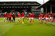 Barnsley players warm up before kick off during the EFL Sky Bet Championship match between Fulham and Barnsley at Craven Cottage, London, England on 23 December 2017. Photo by Andy Walter.