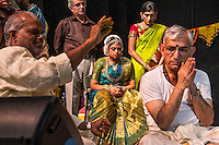 Lincroft, New Jersey, 9/20/14: Hema Ramaswamy (center) celebrates a puja, a Hindu devotional ceremony, with a priest and relatives, including her father Ram (right). A young Indian American woman with Down syndrome, Hema will perform her bharata natyam arangetram, the public presentation of classical South Indian dance after years of study.