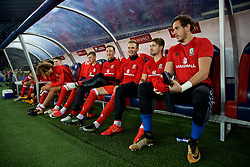 TBILSI, GEORGIA - Friday, October 6, 2017: Wales substitutes Ben Davies, Tom Lockyer, Ryan Hedges, Tom Bradshaw and goalkeeper Daniel Ward on the bench before the 2018 FIFA World Cup Qualifying Group D match between Georgia and Wales at the Boris Paichadze Dinamo Arena. (Pic by David Rawcliffe/Propaganda)