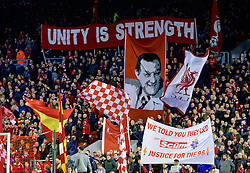 """LIVERPOOL, ENGLAND - Thursday, March 10, 2016: Liverpool supporters on the Spion Kop with banners """"Unity is Strength"""" and """"We Told You They Lied, Justice for the 96"""" before the UEFA Europa League Round of 16 1st Leg match against Manchester United at Anfield. (Pic by David Rawcliffe/Propaganda)"""