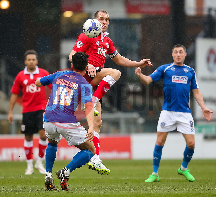 Bristol City's Aaron Wilbraham is challenged by Oldham Athletic's Luke Woodland  - Photo mandatory by-line: Matt McNulty/JMP - Mobile: 07966 386802 - 03/04/2015 - SPORT - Football - Oldham - Boundary Park - Oldham Athletic v Bristol City - Sky Bet League One