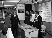 The 1989 Boat Show.   (R89)..1989..10.03.1989..03.10.1989..10th March 1989..Pat the Cope GallagherTD, Minister for the Marine attended the opening of the 1989 Boat Show held at the Point Depot, Dublin. The opening coincided with the minister's birthday...The Minister is pictured discussing state incentives for shiping with staff at the Dublin Port display stand.