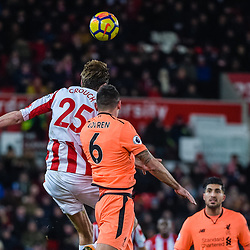 Stoke City forward Peter Crouch (25) wins a header during the Premier League match between Stoke City and Liverpool<br /> (c) John Baguley | SportPix.org.uk