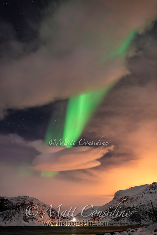 Northern lights through clouds at sunset. (Photo by Travel Photographer Matt Considine)