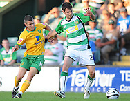 Yeovil - Tuesday, August 11th, 2009: Daniel Schofield of Yeovil and Wes Hoolahan of Norwich City during the Carling Cup 1st Round match at Yeovil. (Pic by Alex Broadway/Focus Images)